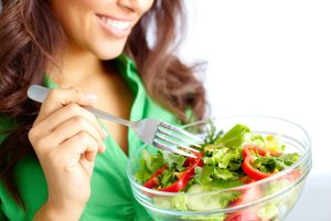 Optimized-bigstock-Close-up-of-pretty-girl-eating-56029796